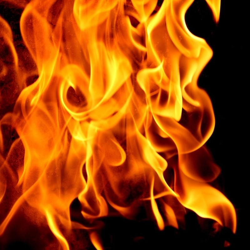 abstract fire on black background in orange and yellow colors