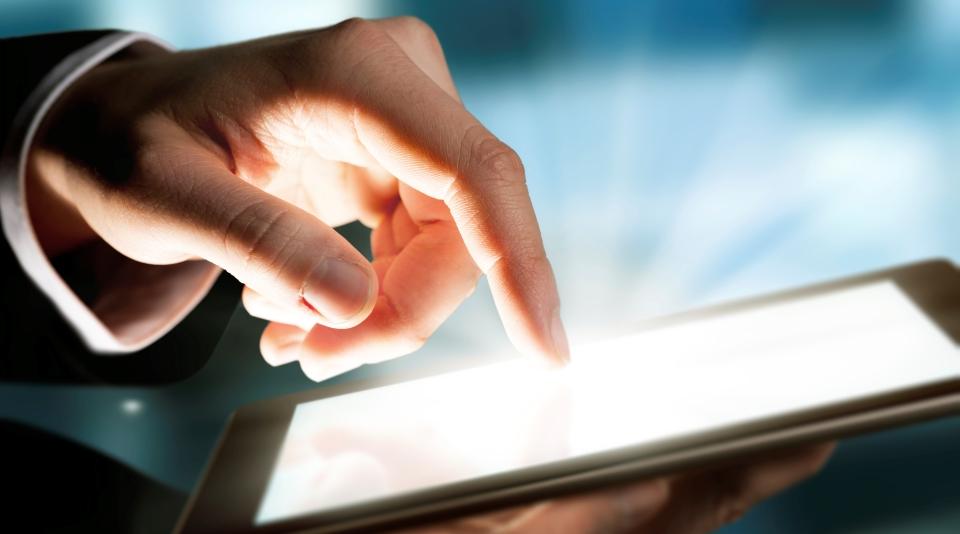 Man hand touching the screen