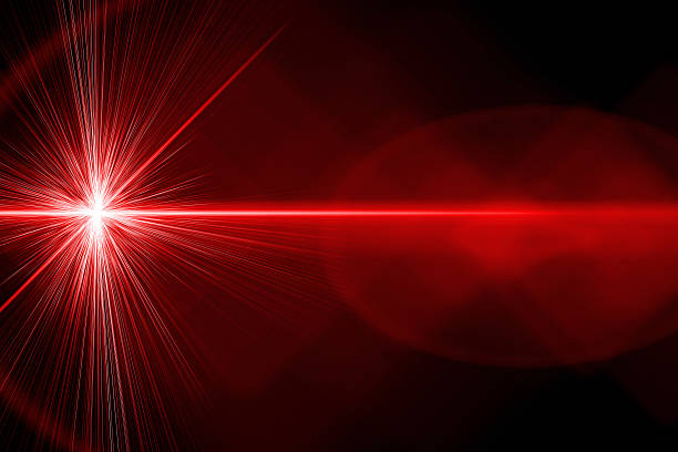 A red bright laser ray on black background